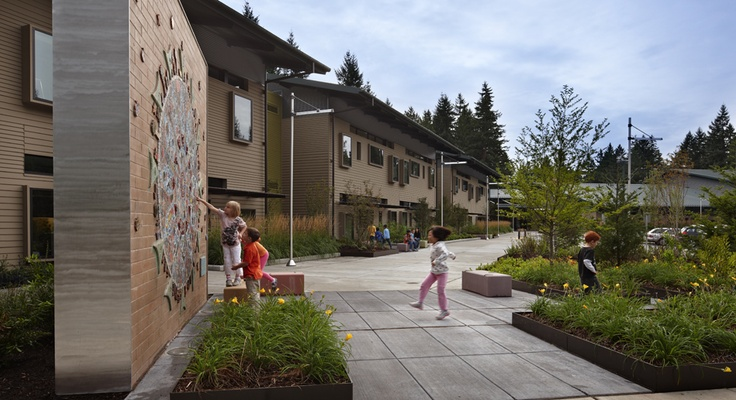 Spirit Ridge Elementary School, Bellevue, WA by McGranahan Architects.  The wall in the foreground is part of the wall of the old school that had special meaning to the community.  My first project with McGranahan Architects was to create renderings of this design.