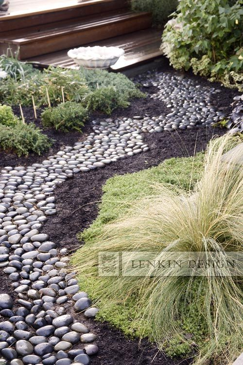 dry stream bed path created with black river rock from lenkin design