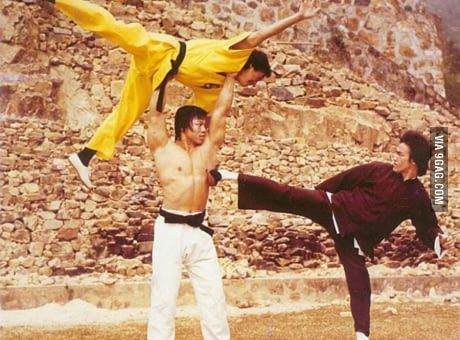 Bolo Yeung fighting Bruce Lee using Jackie Chan as a weapon