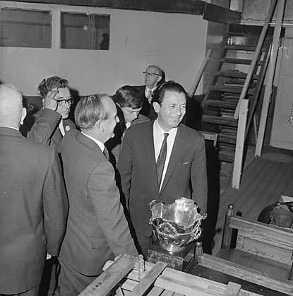 Ivor Evans looking happy after his choir, The Ivor Evans Singers, win the 1966 Eisteddfod.