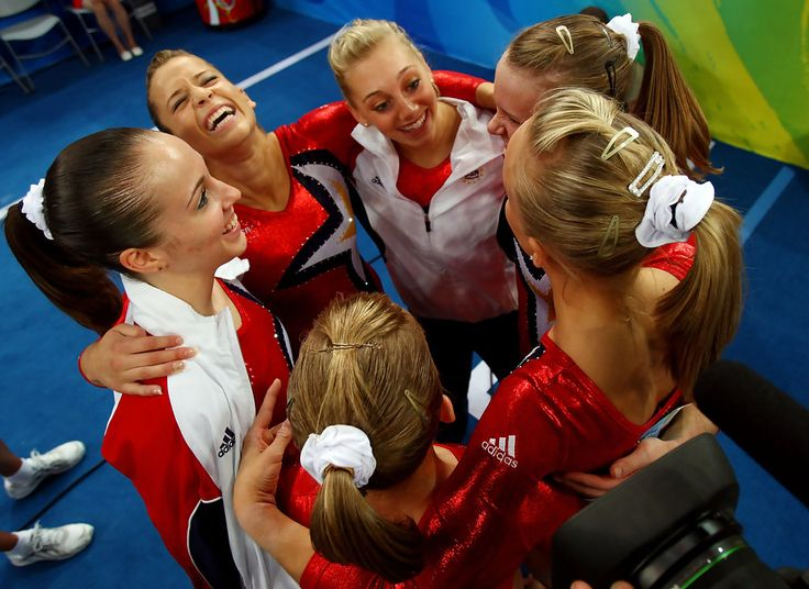 Shawn Johnson Photos Photos - Shawn Johnson, Chellsie Memmel, Alicia Sacramone, Samantha Peszek, Bridget Sloan and Nastia Liukin of the United States reacts after competing in the qualification round for the women's artistic gymnastics event held at the National Indoor Stadium during Day 2 of the 2008 Summer Olympic Games on August 10, 2008 in Beijing, China. - Olympics Day 2 - Artistic Gymnastics