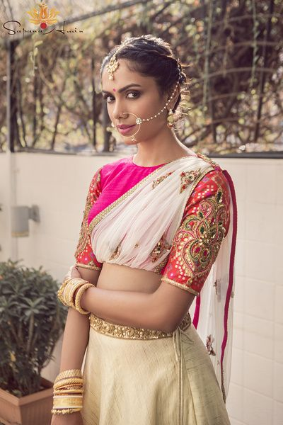pink and white lehenga , attached dupatta silhouette , draped dupatta , nosering , elbow length sleeves, stacked bangles , crop top lehenga , pink and gold lehenga