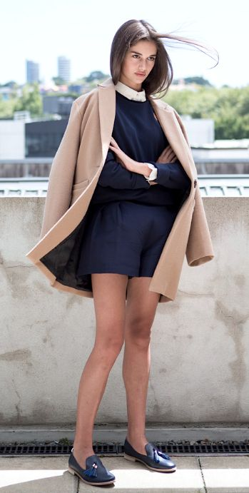 Street Style: Neutral Coat, Black Sweatshirt, White Shirt, Black Shorts and Black Loafers.
