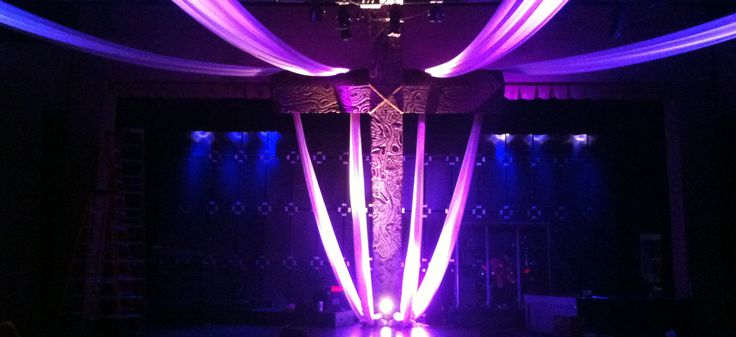 Wes Walker fromWest Cobb Churchin Marietta, GA brings us this Easter stage design. They started by swagging white fabric above their stage and lighting it with LED lighting. The cross was made of...