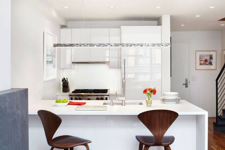 Stools are fabulous White luscious kitchen Colourful and Light Filled Apartment in Manhattan by Axis Mundi Design