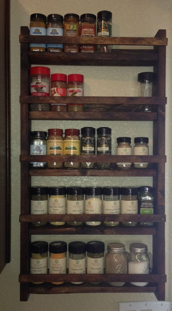 "15"" tall, 28"" wide ,3"" deep (2.5 depth shelf) Probably can fit 4 C&B oval jars per shelf Rustic Wood Spice Rack"