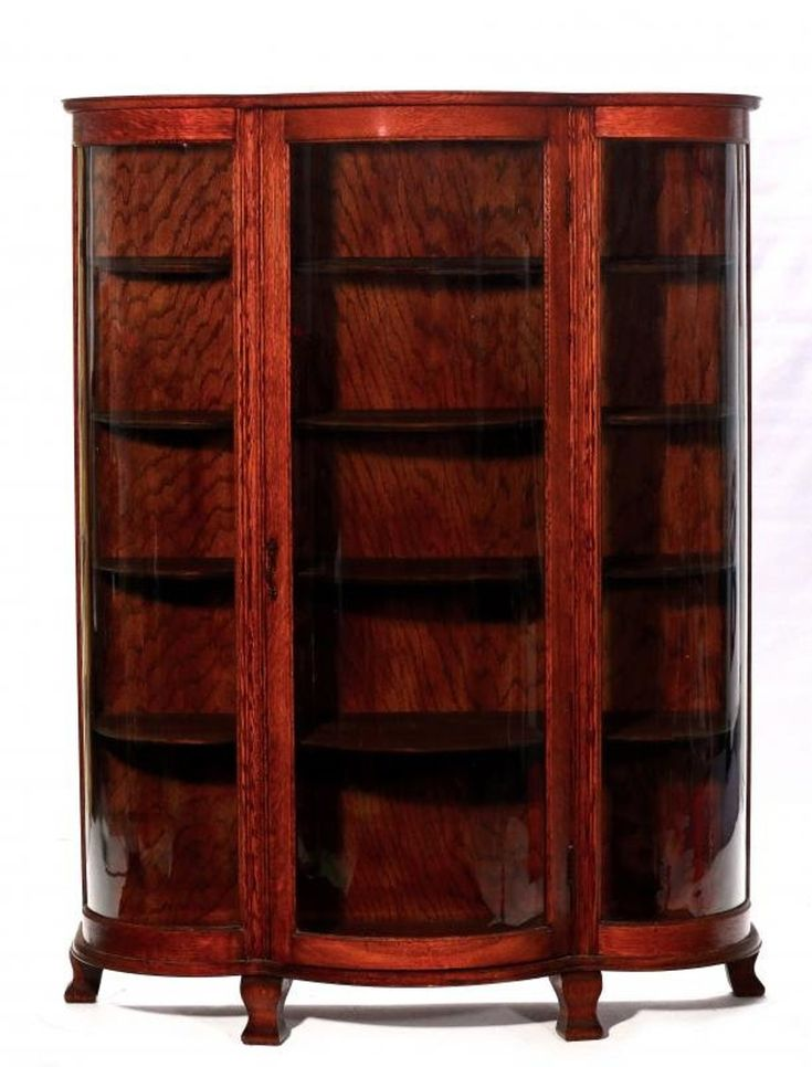 A CIRCA 1900 OAK CHINA CABINET WITH ROUNDED GLASS