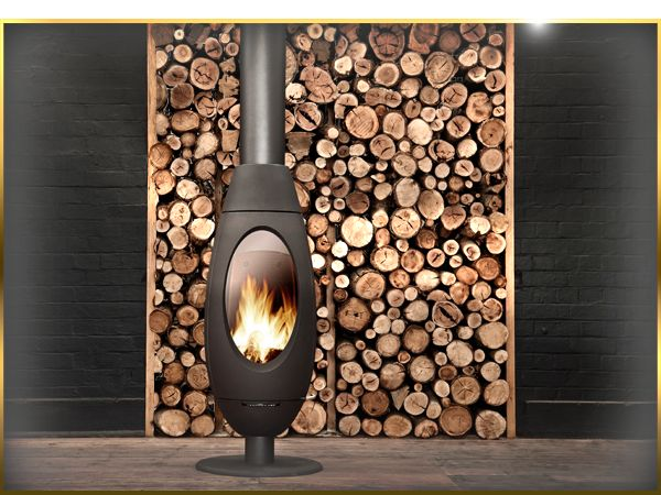 The handmade, imported French Oblica Ove fireplace is a centrepiece of the living room