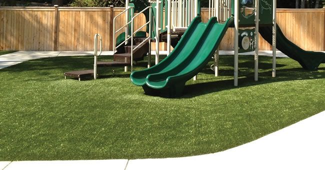 Synthetic Turf Offers The Natural Look Of Grass With Low Maintenance This Safe Surfacing Is Available For A R Playground Public Space Design Playground Safety