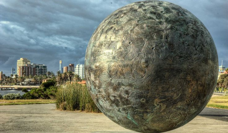The Sun 2 -  This sculpture represents the sun in a scale model of the solar system installed along the St Kilda foreshore, Melbourne Australia. The scale is one-billionth actual size, and on that scale the sun is 139cm in diameter. The earth is 1.28cm diameter and is 150 meters away. Pluto is 1/4 cm across and is 5.9 km distant.