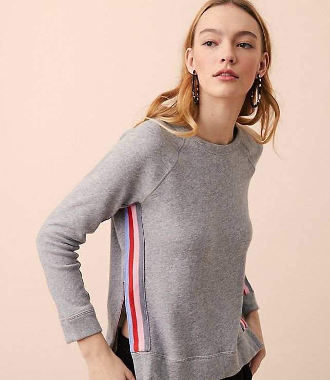 Treated to the prettiest rainbow appliques at the seams, this soft cotton terry style is your wardrobe's pot of gold. Round neck. Long sleeves. Side slits.