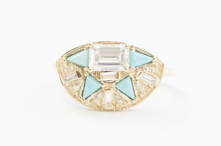 Custom MOCIUN emerald cut and baguette cut white diamonds with turquoise triangle in 14K yellow gold setting.