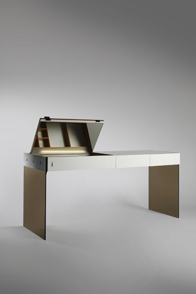 Antoine Philippon and Jacqueline Lecoq. France. Coiffeuse, 1962.  Palissander, laminate, aluminum, smoked glass, leather.  27.56 x 61.02 x 20.08 inches 70 x 155 x 51 cm Unique, commissioned for private client