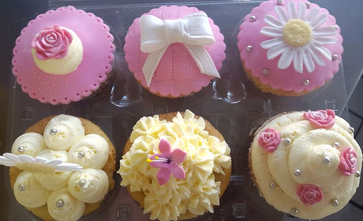 Floral and bows gourmet cupcakes by So'Licious Cakery.