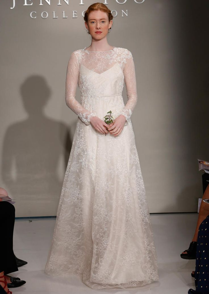 Jenny Yoo Fall 2016 wedding dress with sheer lace sleeves and high neck with lace detail on bodice and flowing skirt | https://www.theknot.com/content/jenny-yoo-wedding-dresses-bridal-fashion-week-2016