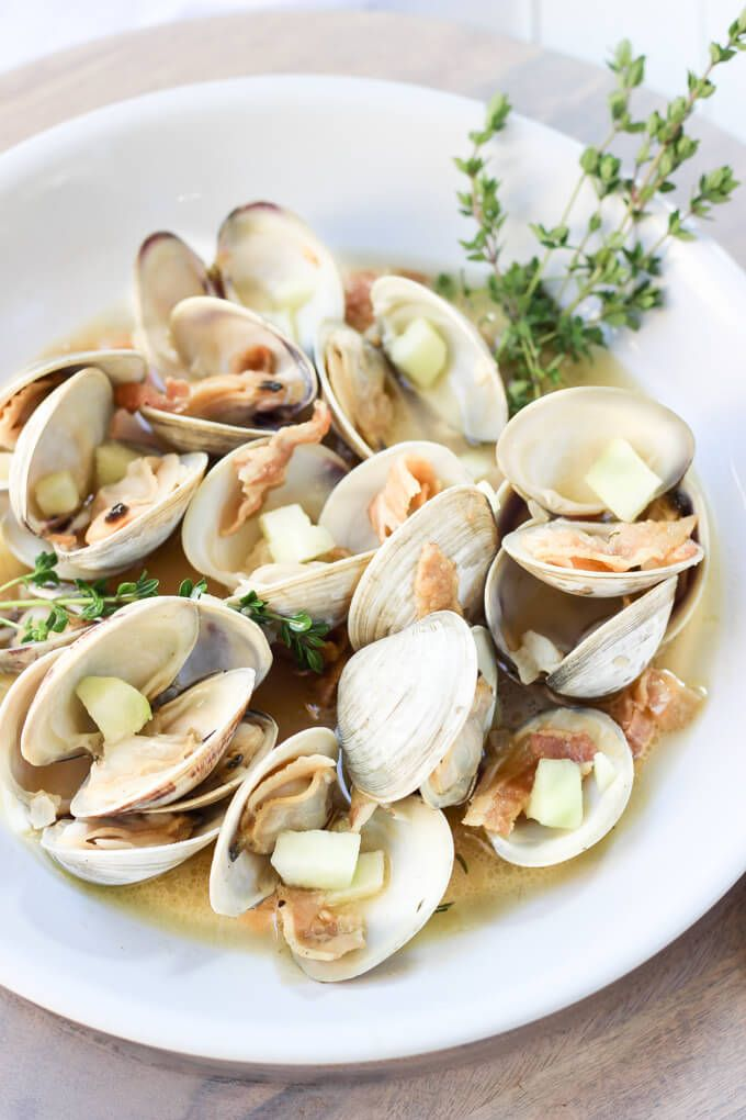 Hop Infused Irish Cider Steamed Clams       2 lbs little neck clams, olive oil, pancetta, unsalted butter, shallot, garlic, hopped hard cider, 2 thyme sprigs, 1/2 granny smith apple, lemon