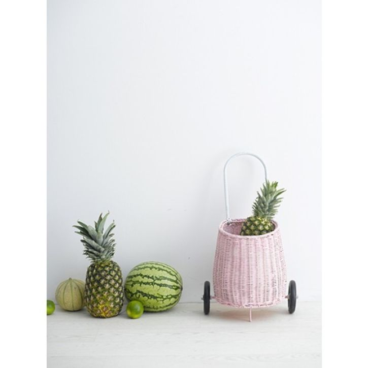 pink woven basket on wheels