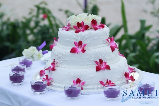A wedding cake is a traditional cake served to the guests at a wedding reception. It is usually a large cake with multiple tiers and heavily decorated with marzipan and icing. It is also common to add flowers which match the bride's bouquet along with gold rings, doves and horseshoes, which signify luck.