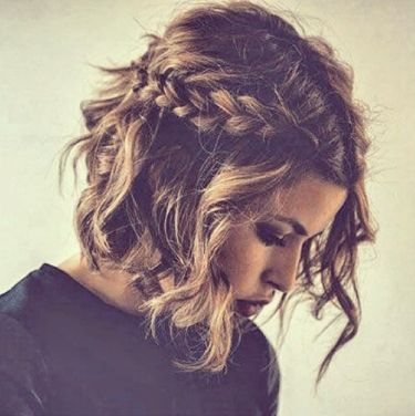 Wedding Hairstyles: Loose tousled hair tied back with pigtails