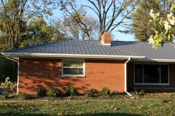 Nice updated roof on this mid century home i like this for Metal roof pictures brick house