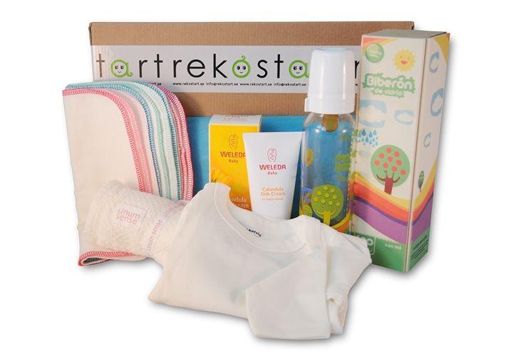 Prenumerationsbox/presentbox nr 2, ålder: 2-4 månader. Nappflaska i glas m naturgumminapp, tvättlappar i ekologisk bomullsflanell, ekologisk body från Katvig och Zinkkräm från Weleda.