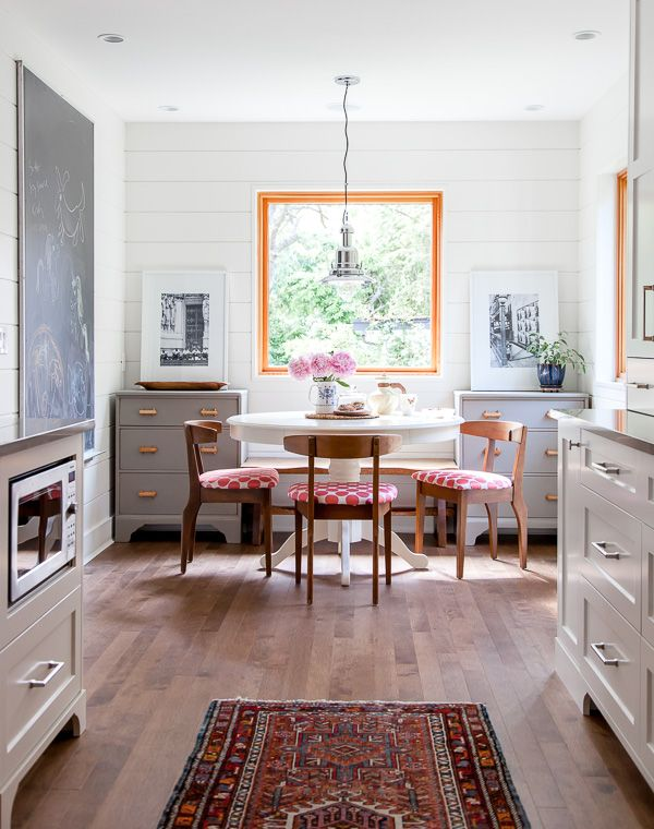gray cabinets, that rug and under the counter microwave. Also the dressers flanking a bench seat. Great way to add some storage in an eat-in kitchen. Instead of the window add a large piece of artwork or mirror.