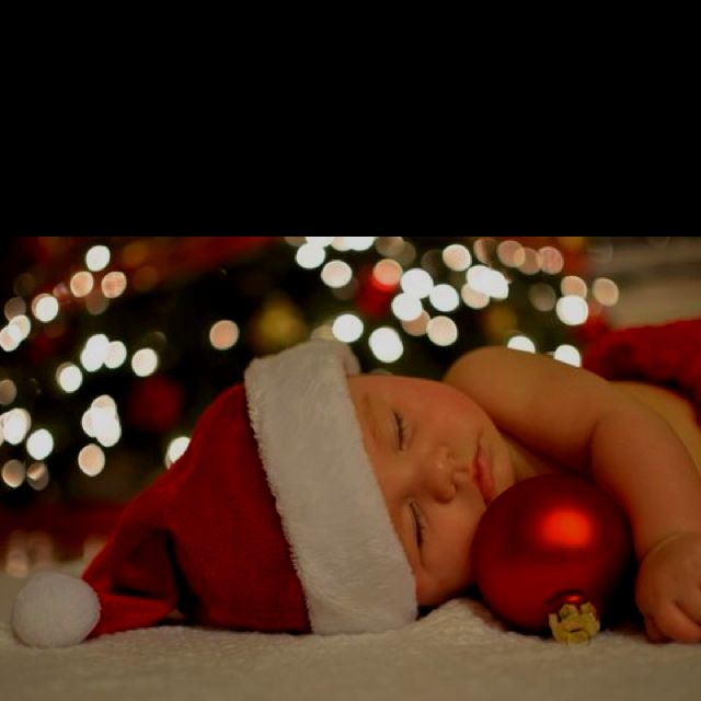 Adorable newborn photo for Baby's First Christmas! I like the lights in the background. Newborn photography | holiday photography | christmas photos