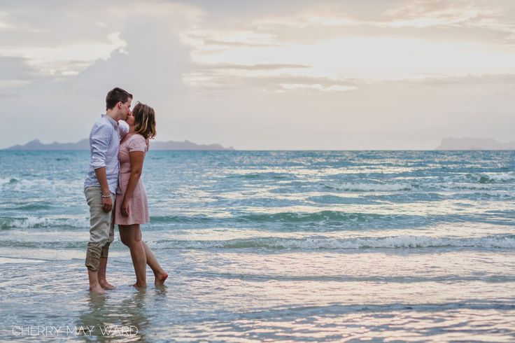 sunset kiss in the water, Koh Samui engagement photos, young couple engaged to be married, in love, happy couple