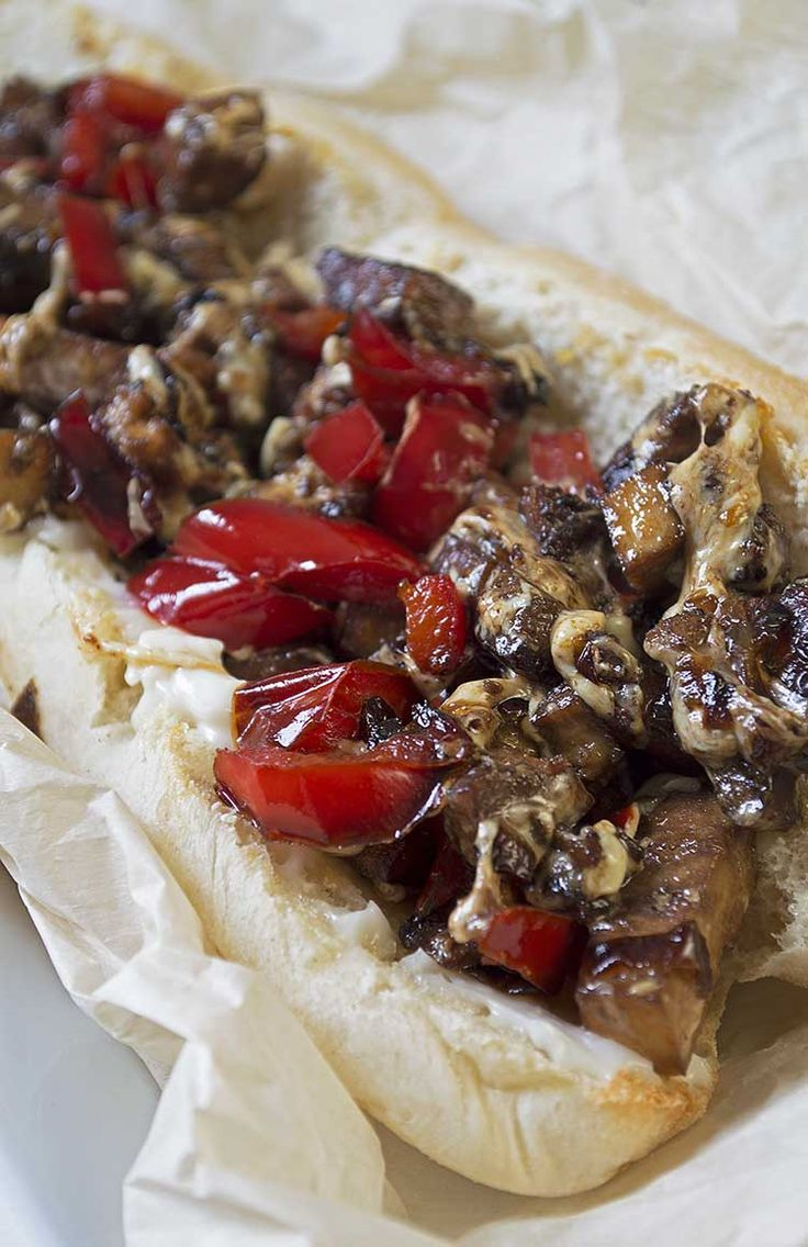 """This vegan Philly cheese steak sandwich is awesome. Ooey gooey, perfectly seasoned """"cheese steak"""" filling on a warm toasty bun. Satisfying and delicious.   www.vegandaydream.com"""
