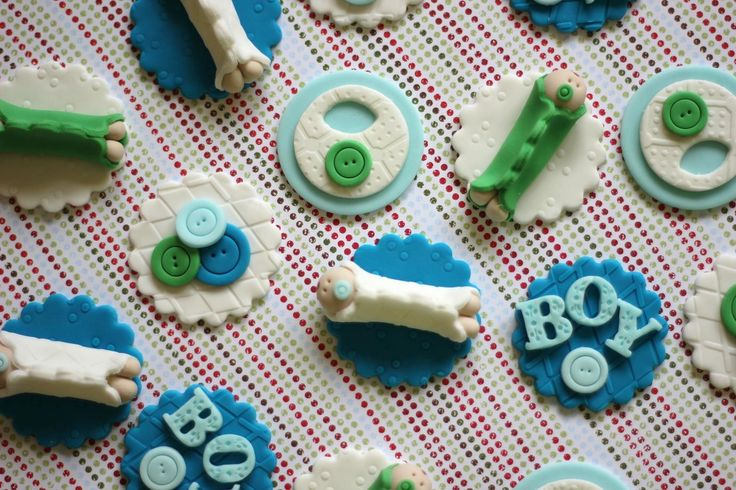 Baby boy fondant cupcake toppers.  Available at https://www.etsy.com/shop/LesPopSweets?ref=hdr_shop_menu