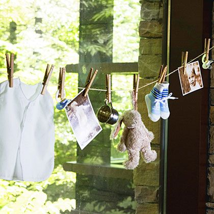 I loved how my clothesline turned out for a baby shower - I included tiny clothes, tiny socks, baby pictures of the mom and dad to be, and tied scraps of ribbon in between the pins.  so easy and pretty.