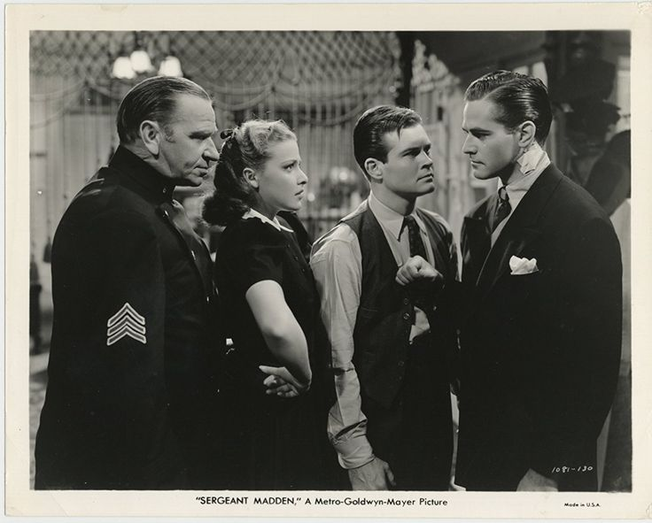 Wallace Beery, Tom Brown, Alan Curtis, and Laraine Day in Sergeant Madden (1939)
