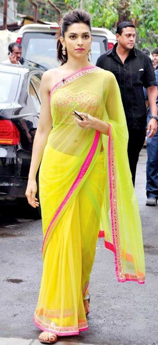 Deepika Padukone in a yellow net sari by designer Arpita Mehta. Bridelan - a personal shopper & stylist for weddings. Website www.bridelan.com #Bridelan