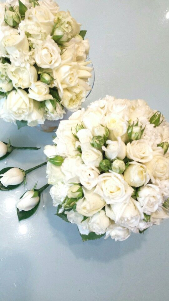 White wedding flowers for the bride bridesmaids and