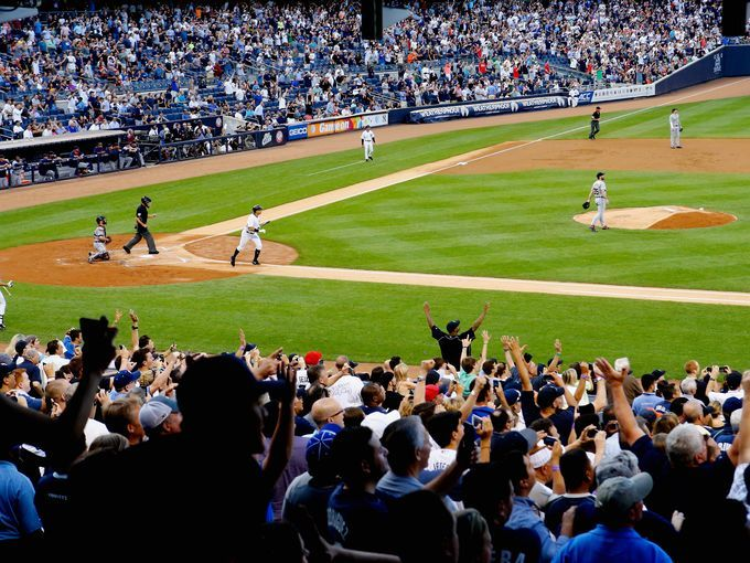 Yankees' Alex Rodriguez hits a home run for his 3000th career hit in the first inning against Justin Verlander of the Detroit Tigers.