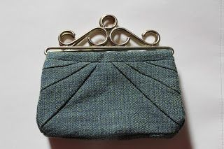 Embroidery wall hangers turned in to handles for this adorable clutch with fabric I've woven in goose eye pattern.
