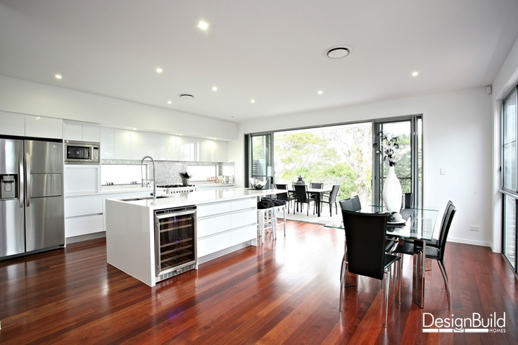 White kitchen and open plan dining.