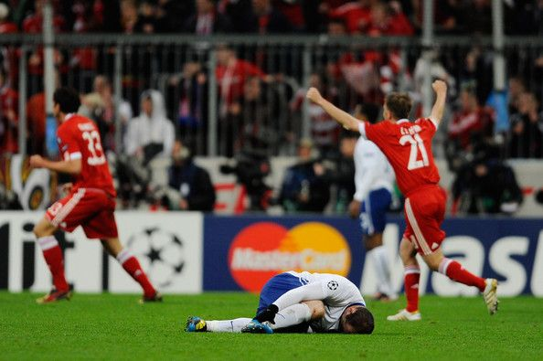Bayern Muenchen players celebrate as Wayne Rooney of Manchester United lies on the pitch injured during the UEFA Champions League quarter final first leg match between Bayern Muenchen and Manchester United at the Allianz Arena on March 30, 2010 in Munich, Germany.