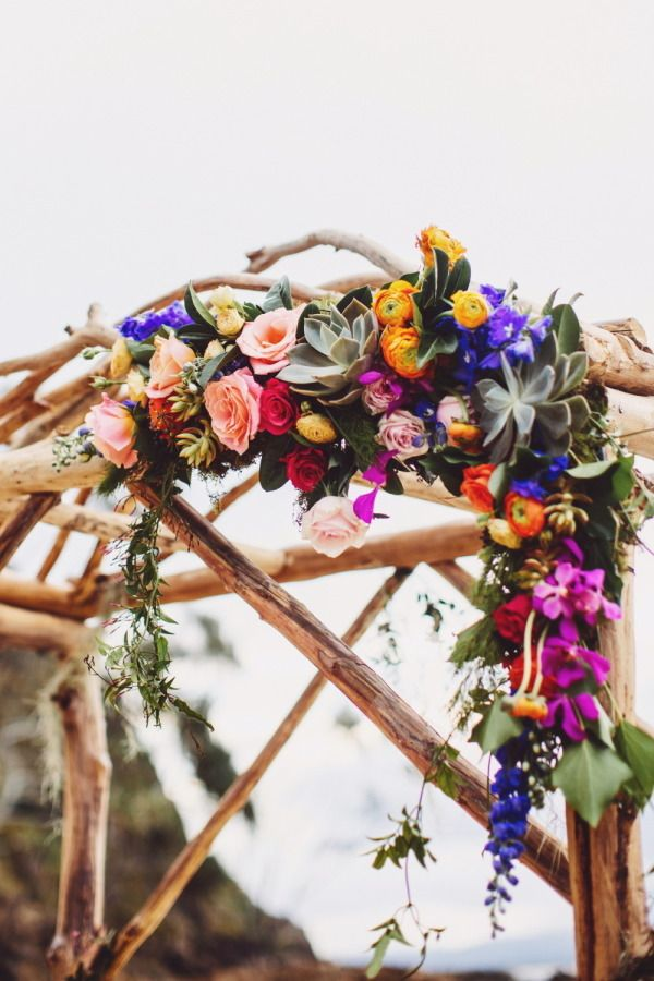 Colorful floral-adorned arch: http://www.stylemepretty.com/australia-weddings/new-south-wales-au/byron-bay/2015/08/14/elegant-colorful-beach-wedding/ | Photography: Ivy Road - http://ivyroadphotography.com.au/