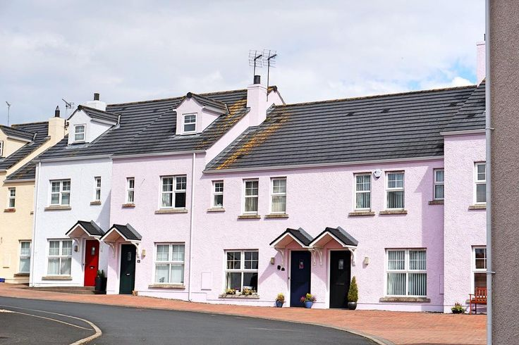 Sometimes you just need a little color in your life. So why not paint your house pink!   Bushmills, Northern Ireland