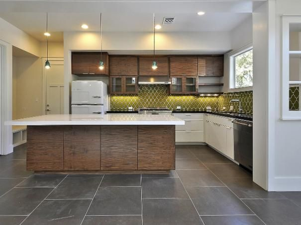 Photo of White Eclectic Kitchen project  by Fireclay Tile