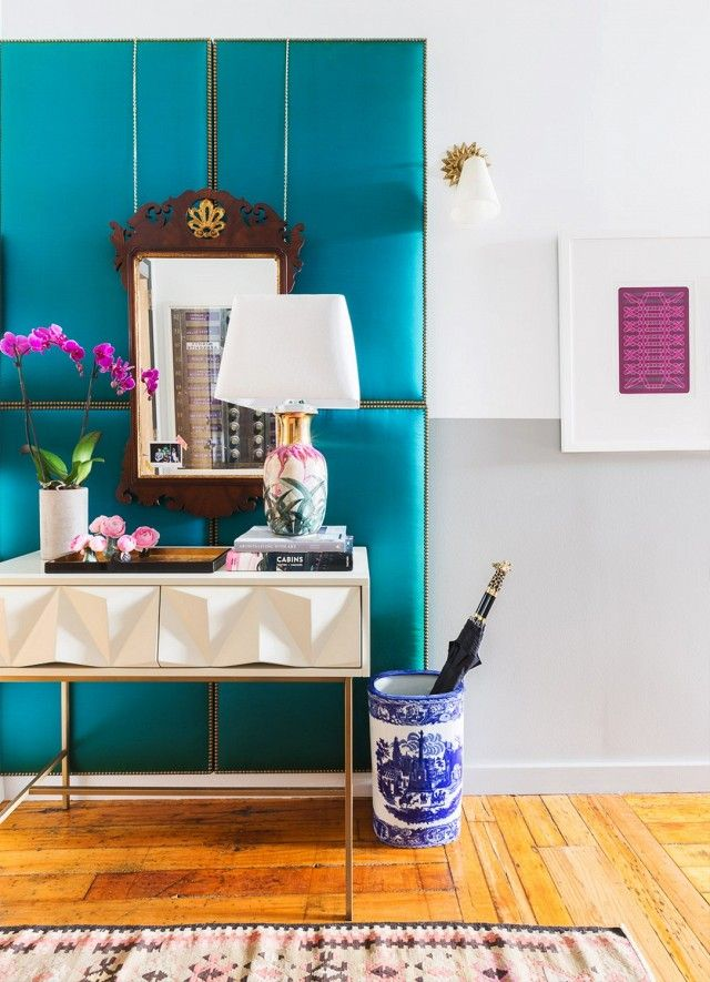 Entryway with a pop of cobalt blue, a vintage mirror and a white geo console
