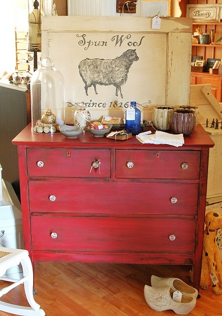 love this red painted dresser and rubbed with a walnut stain!