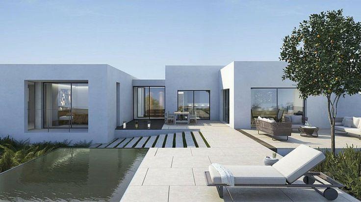 Vaste terrasse vue sur le bois de cette maison d'architecte