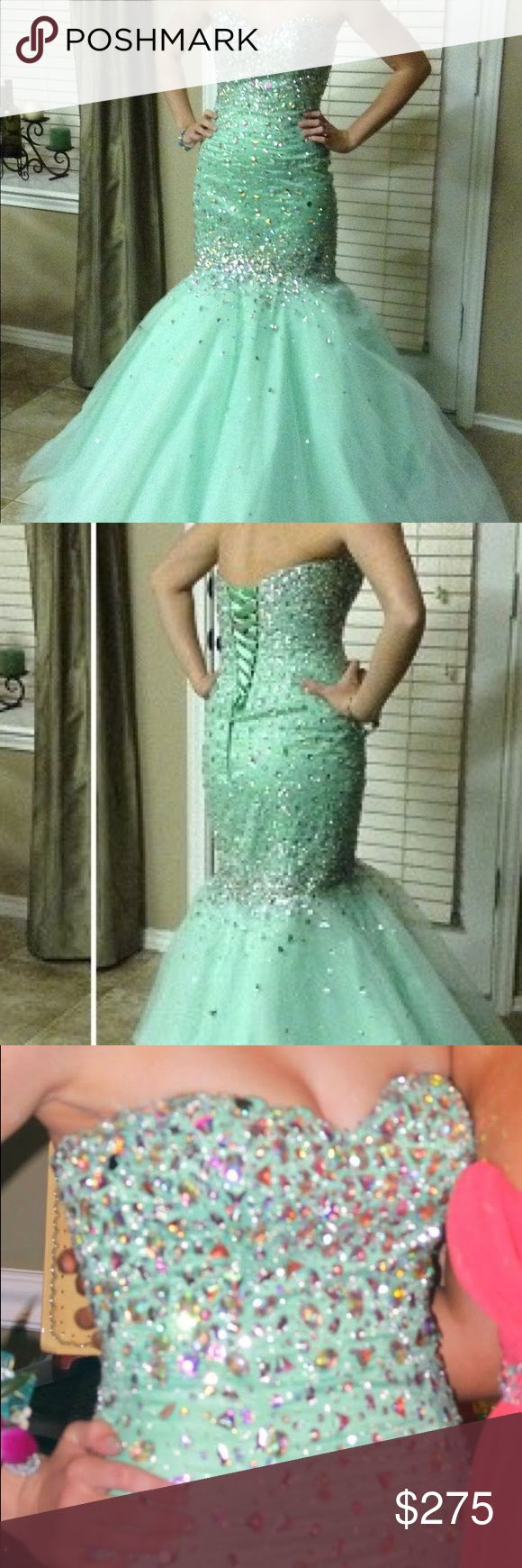 Mori Lee prom dress Purchased from a dress boutique for just over $500. Mint green mermaid corset style with lots of bling. Excellent condition. Sized as a 6 on the tag but fits like a 0-2. My daughter is 5'5, 110 lbs, size 34B for some size comparison. Mori Lee Dresses Prom
