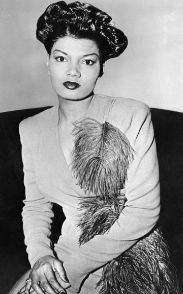 Pearl Bailey is often forgotten as one of Hollywood's most beautiful women due to the era when Hollywood did not find women of color as beautiful. Hollywood was wrong because Ms. Pearl is a beautiful classic and timeless beauty that is often emulated.