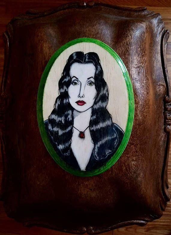 Hey, I found this really awesome Etsy listing at https://www.etsy.com/listing/533650148/morticia-addams-5-x-7-oval-wood-plaque