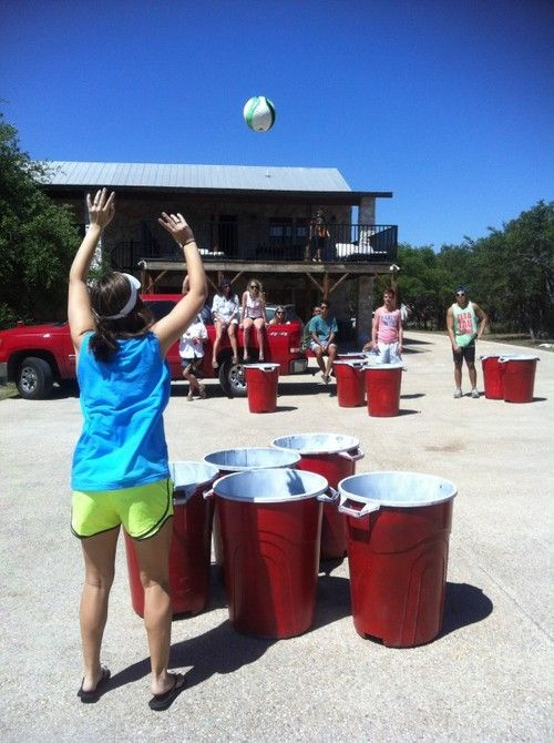 Super Beer Pong- Trash cans as red solo cups and a volleyball as the ping pong ball.