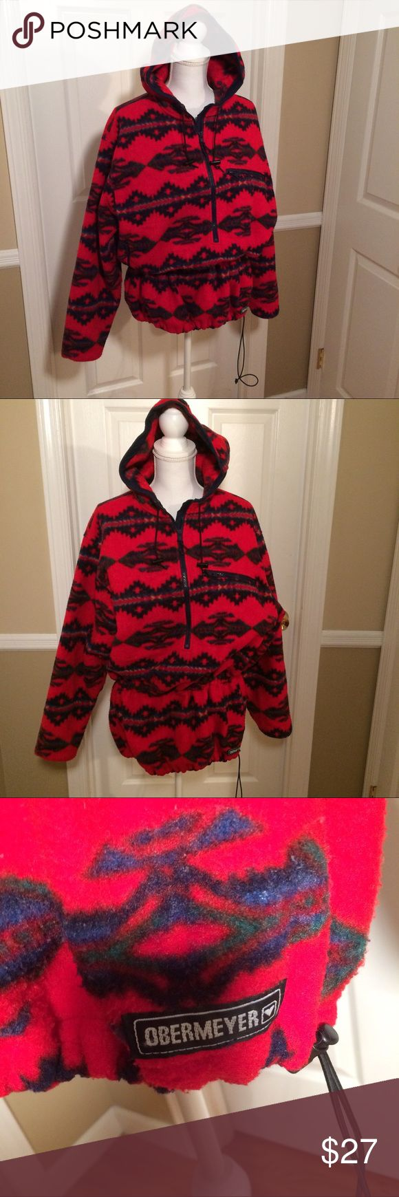 Obermeyer fleece jacket Ladies Obermeyer fleece pullover with hood. Barely worn. Beautiful quality. Red Aztec print. Drawstring drop waist. Deep V Neck Zipper. Zipper breast pocket is side hand pocket. So so comfortable. Used for skiing in Aspen only a few times. Obermeyer Jackets & Coats