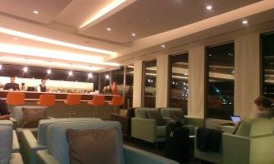 Etihad Airways guest lounge seating area with bar at Sydney Airport - Etihad business class review